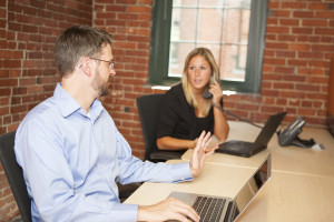 Two office workers discussing remarketing