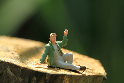 Figurine man waving goodbye